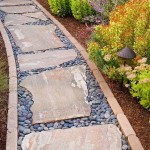 A pathway lined in brick with stepping stones and pebble filler   Outdoor Areas